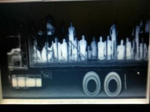Handout shows illegal immigrants from Central America, Nepal and Bangladesh in a trailer truck after being detected by police X-ray equipment at a checkpoint in La Pochota outside Tuxtla Gutierrez